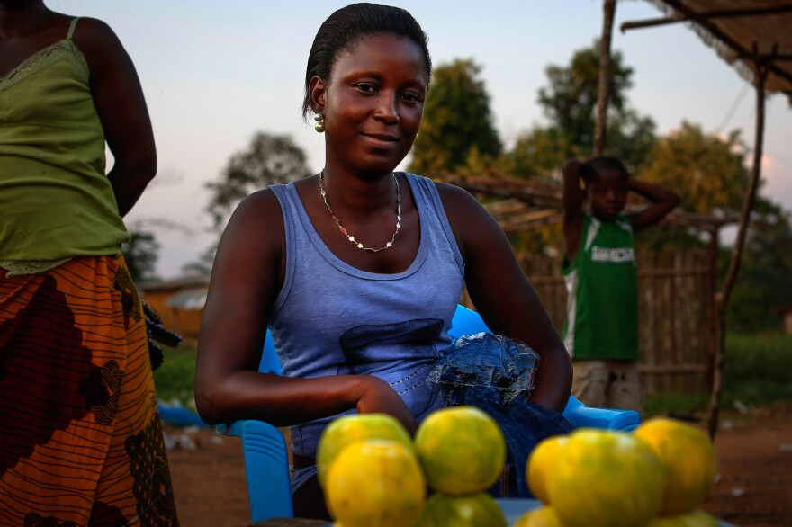 """Just off Ganta's main street, 18-year-old orange seller Bebe Gono says she's struggling. """"We are trying to find the little we can afford,"""" she says."""