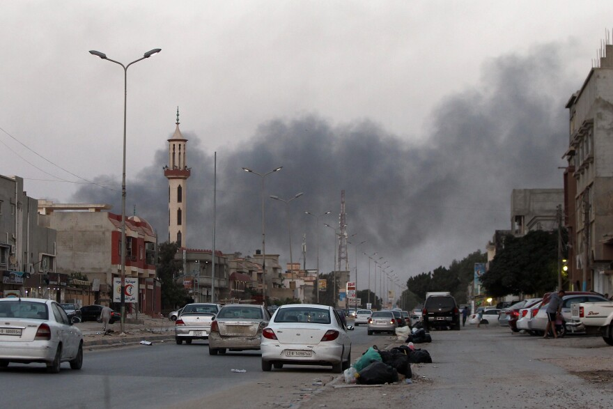 Smoke billows from buildings during clashes between Libyan security forces and armed Islamist groups in the eastern coastal city of Benghazi on Saturday. There has been frequent fighting in and around the capital, Tripoli, as well as Benghazi and other parts of the east.
