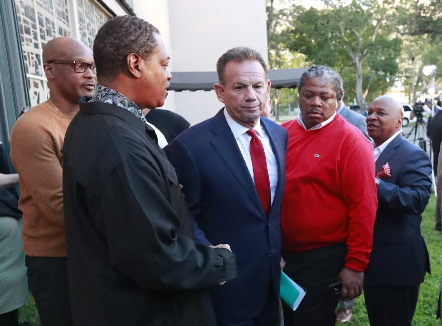 In this Jan. 11, 2019 file photo suspended Broward County Sheriff Scott Israel, center, leaves a news conference surrounded by supporters after new Florida Gov. Ron DeSantis suspended him, in Fort Lauderdale, Fla.