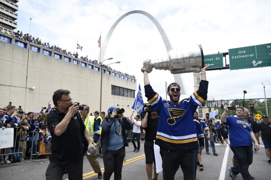 Blues defensemen Joel Edmundson carries the Stanley Cup at the end of the parade. June 15, 2019