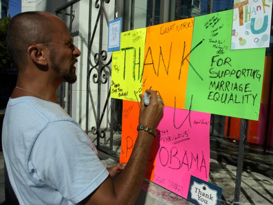 """Kelly Rivera Hart of San Francisco, California, adds his thoughts to a """"thank you"""" card for President Obama posted at the intersection of Castro and 18th Streets in San Francisco on Wednesday, May 9. Obama spoke earlier in the day of his personal beliefs on gay marriage."""