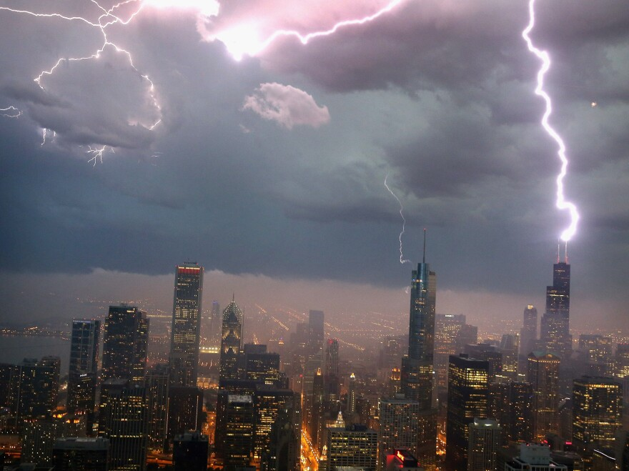 Quite a show in Chicago: Lightning struck the Willis Tower (formerly the Sears Tower, at right) on Wednesday as the storm system moved through.