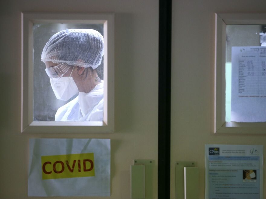 A nurse in the Eugenie Hospital in Ajaccio, on the French Mediterranean island of Corsica, on April 23. France appears to have had its first case of COVID-19 in December, a month earlier than doctors thought.