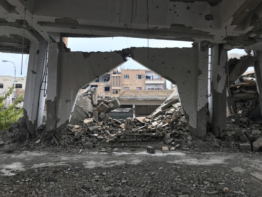 A church near the school was destroyed during the fight to oust ISIS from Raqqa, Syria.
