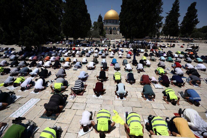 Muslim men practice social distancing during Friday prayers next to the Al-Aqsa Mosque in Jerusalem's Old City in July.