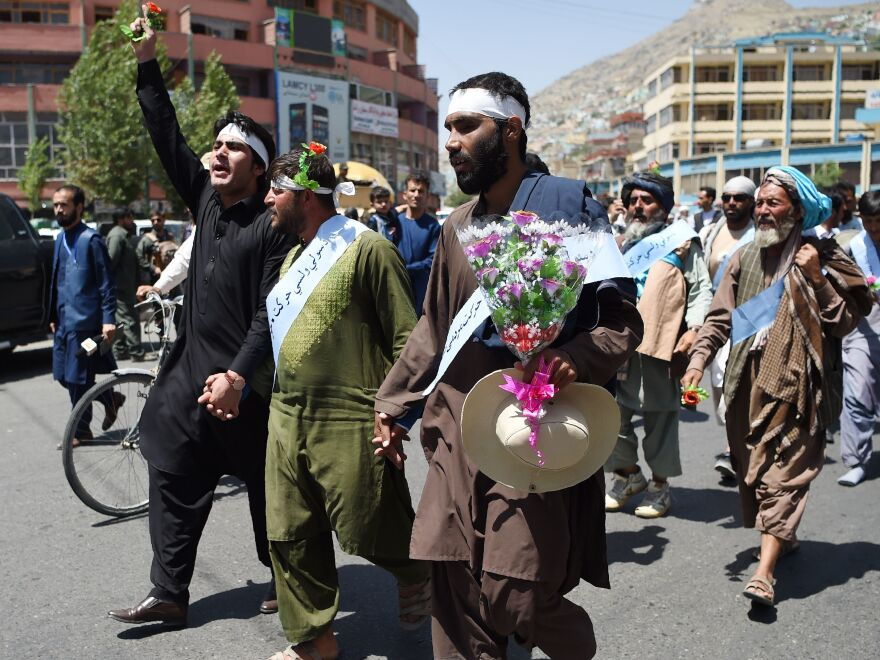 Afghan peace activists demand an end to war as they arrive in Kabul in June 2018, after marching hundreds of miles from Helmand.