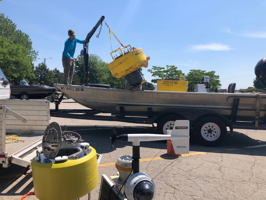 Buoys being loaded for deployment on the bay of Green Bay.