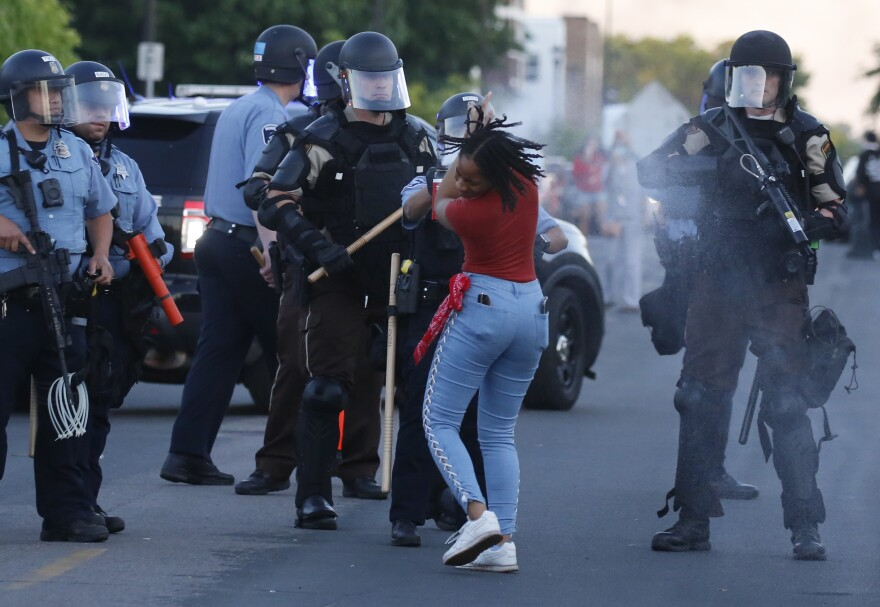 A woman is pepper-sprayed by law enforcement in Minneapolis during a demonstration against the death of George Floyd.