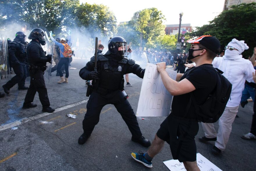 Police officers clash with protestors near the White House on June 1, 2020 as demonstrations against George Floyd's death continue.