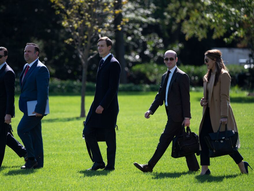 Hope Hicks walk to Marine One to depart from the South Lawn of the White House on Wednesday.