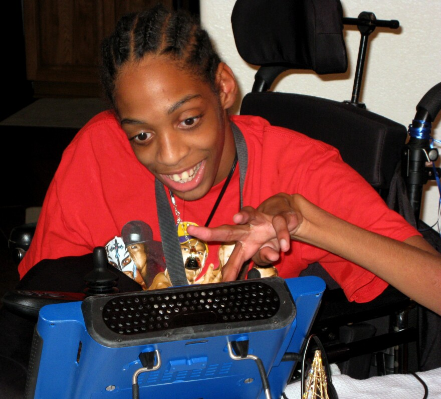 Tres Whitlock types on the DynaVox tablet that serves as his voice. Whitlock, 17, has cerebral palsy and can't speak on his own. StateImpact Florida reported on the difficulty Whitlock, and other special needs kids, have had trying to enroll in Florida charter schools.