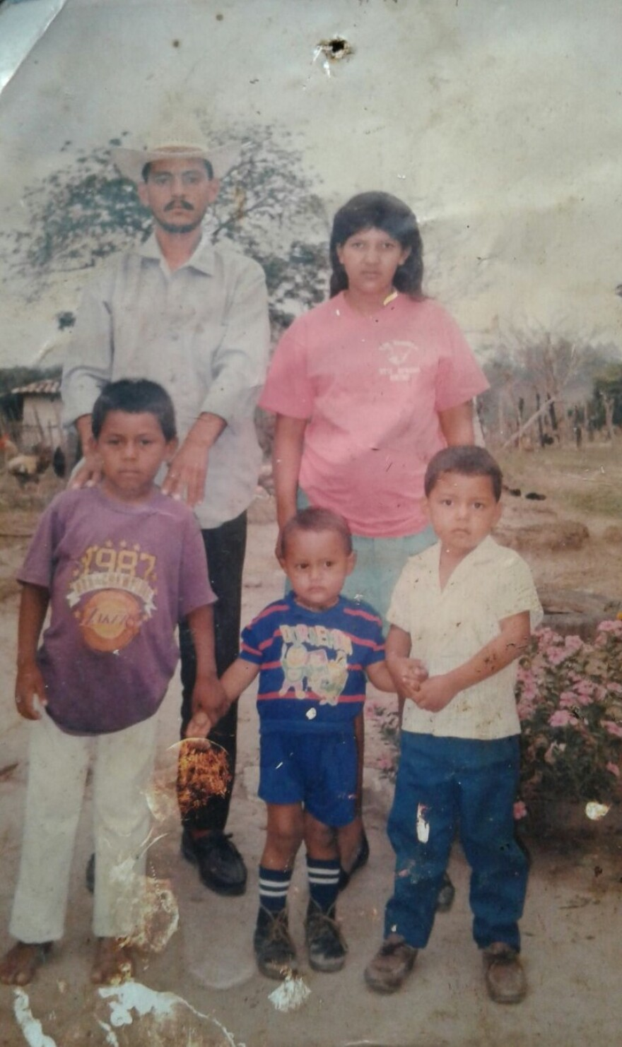 Yency Contreras (purple shirt) with his family in Honduras as a boy. He left home at 17 for the U.S., eventually becoming a citizen and a CMPD officer.