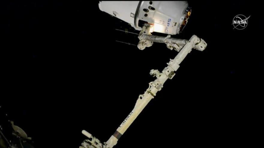 The SpaceX Dragon cargo spacecraft was successfully captured with the Space Station's robotic arm.