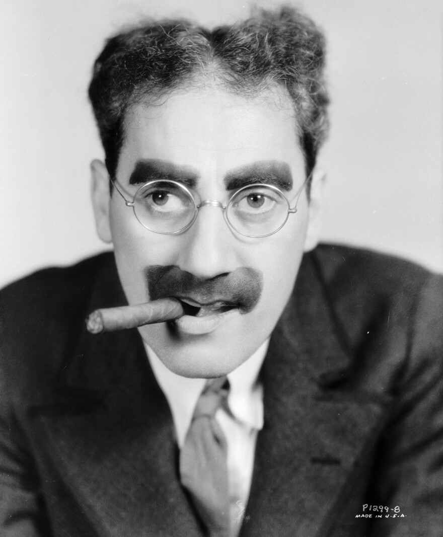 American actor Groucho Marx, with his trademark mustache, glasses and cigar. We can't be sure that this cigar was Cuban.