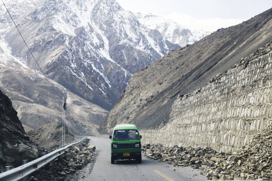 A minivan plies the Karakoram Highway in far northern Pakistan, dodging small piles of rock that have dislodged from the steep mountain slopes that loom over the road. The road is barely wide enough for two vehicles as it reaches the Chinese border.