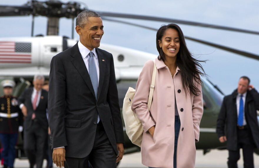 President Barack Obama jokes with his daughter Malia Obama as they walk to board Air Force One from the Marine One helicopter, as they leave Chicago en route to Los Angeles last month.