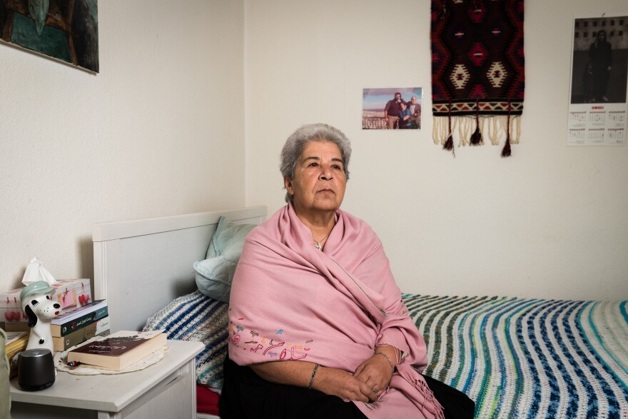 Fadwa Mahmoud sits in her apartment in Berlin. Her husband and her son both disappeared in Syria in 2012. She believes they are still alive, and she has not stopped looking for them since.