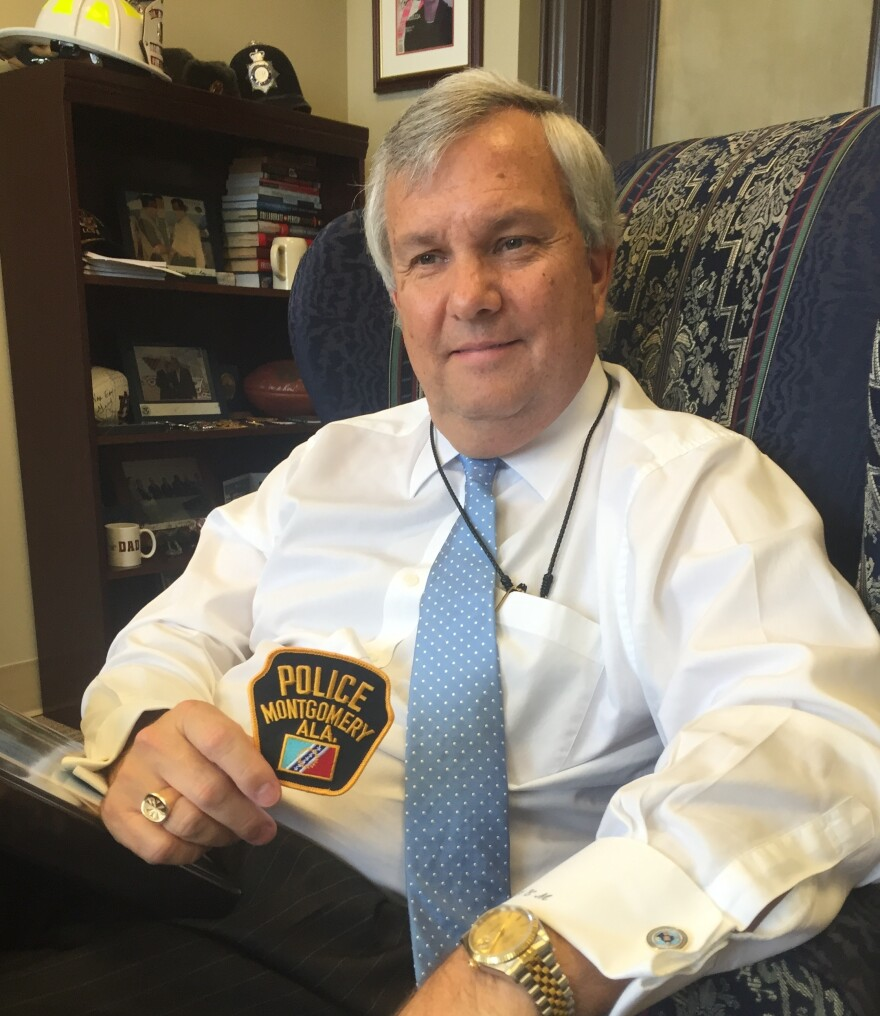 Montgomery Public Safety Commissioner Chris Murphy holds the city's police patch — the same one that officers wore when they arrested Rosa Parks and Martin Luther King.