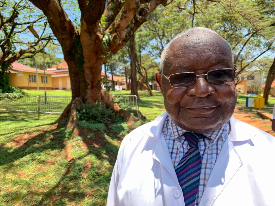 Dr. Ignatius Kakande on the grounds of a hospital in Kampala. In the late 1990s he was an early champion of using liquid morphine as solution to the shortage of effective and cheap painkillers in Uganda.