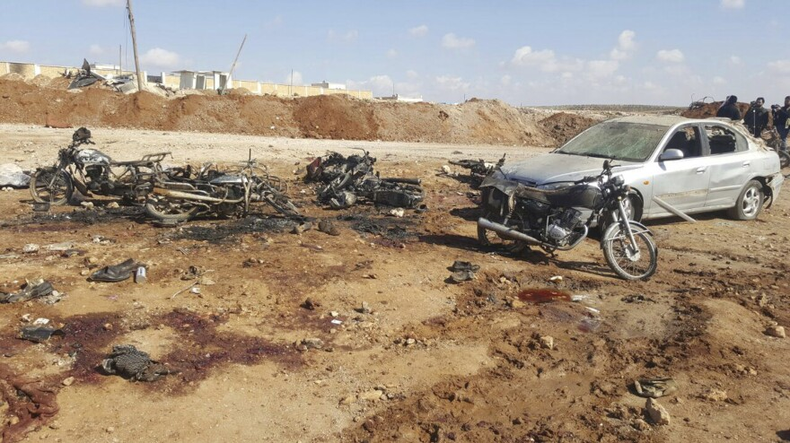 Burned, twisted metal from motorcycles covered an area where a suicide attacker blew up his small pickup truck outside a security office on Friday in the village of Sousian in northern Syria.