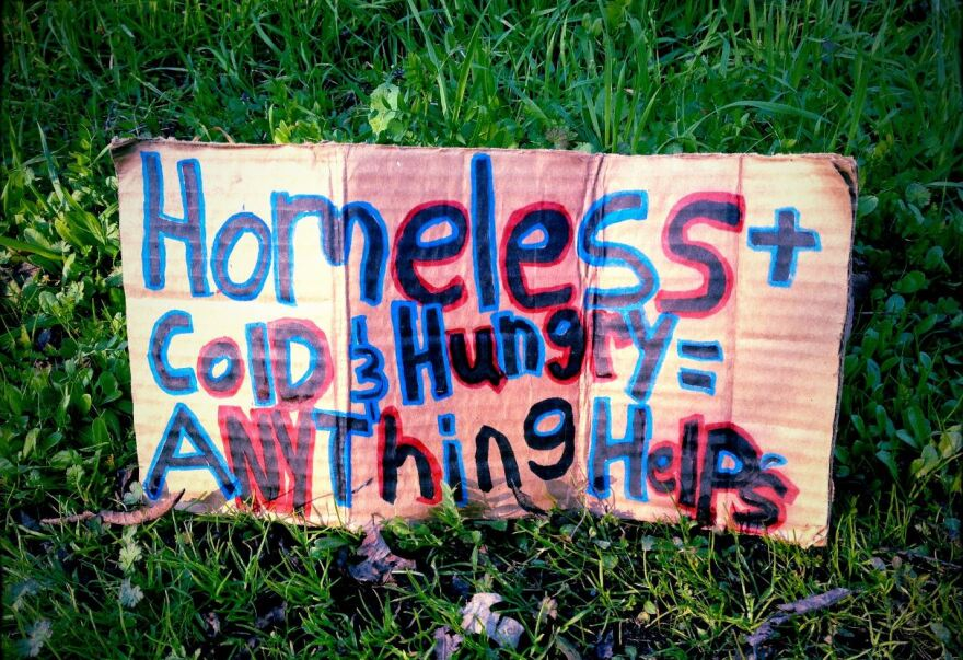 Photo of sign asking for help