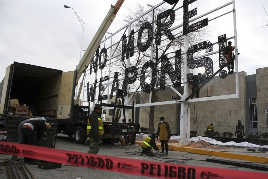 "The ""No More Weapons"" billboard is installed in Ciudad Juárez in 2012."