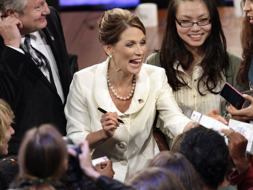 <p>Rep. Michele Bachmann greets supporters after Tuesday's debate in New Hampshire. She saw her political fortunes rise earlier in the summer but has since fallen back in the polls. </p>