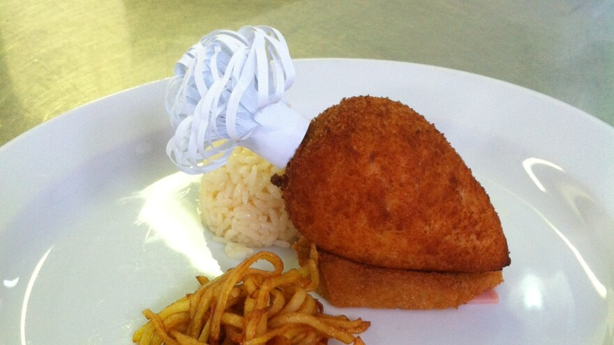 Chicken Kiev made by Viacheslav Gribov, head chef at Kiev's Hotel Dnipro, comes with a small bone sticking out one end. If done properly, some of the butter inside will remain unmelted.