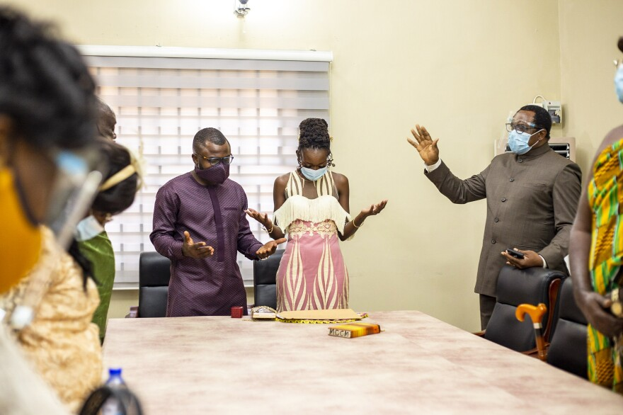 """Despite the threat of COVID-19, a number of guests donned masks for a small wedding ceremony. """"There is so much beauty in human resilience,"""" says photographer Nicholas Seun Adatsi. """"Like how a flowing river makes its way through or around obstructions, we always find a way to continue forward on our path of life."""" <em>August 4. Accra, Ghana.</em>"""