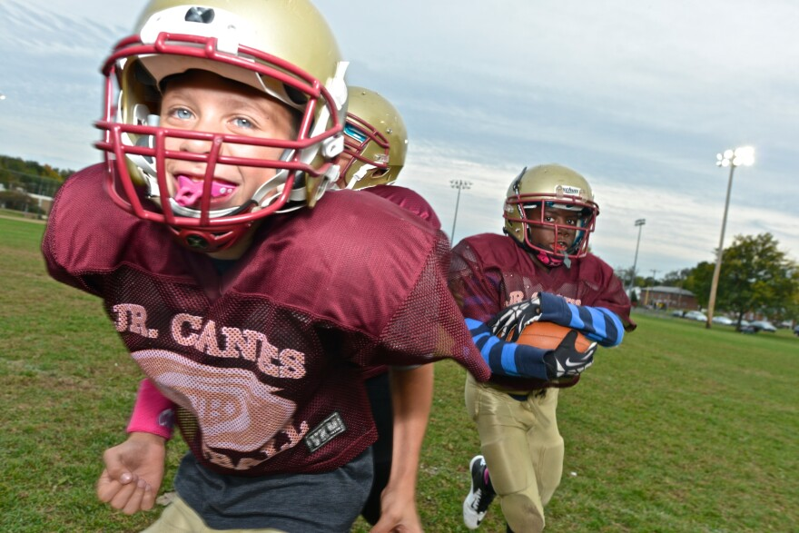 The New Britain Jr. Hurricanes participate in a Heads Up Football clinic on Oct. 9 in New Britain, Conn. The program is teaching kids safer tackling across the country.