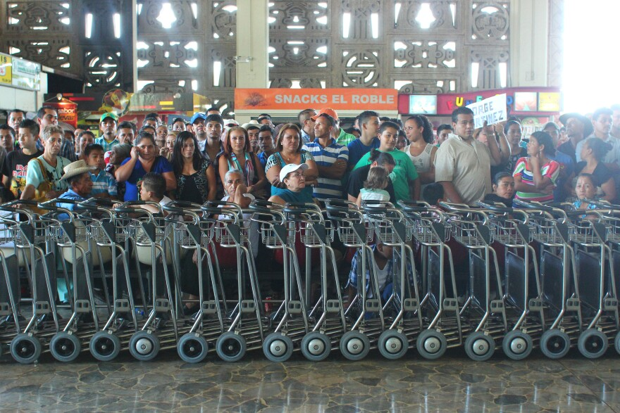 030518_sw_nelson_pereira__walking_out_of_comalapa_airport__0.jpg