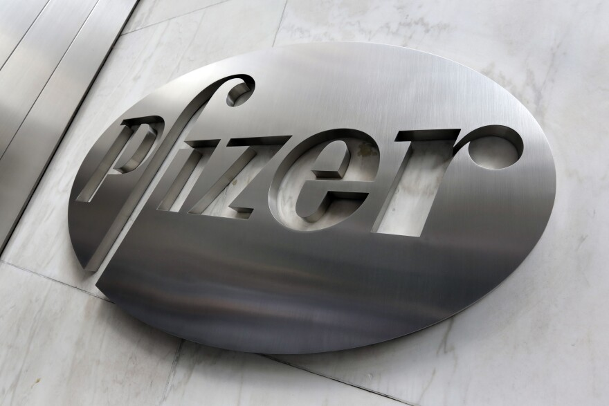 This Dec. 4, 2017, file photo shows the Pfizer company logo at the company's headquarters in New York.