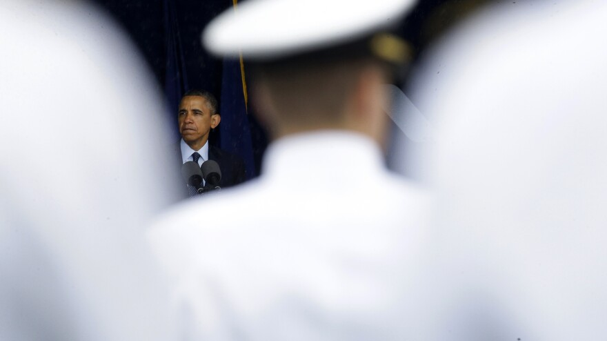 President Obama speaks at the commencement ceremony for the United States Naval Academy in Annapolis, Md., on Friday. The president urged new graduates to exhibit honor and courage in tackling incidents of sexual assault as they assume leadership positions in the military.