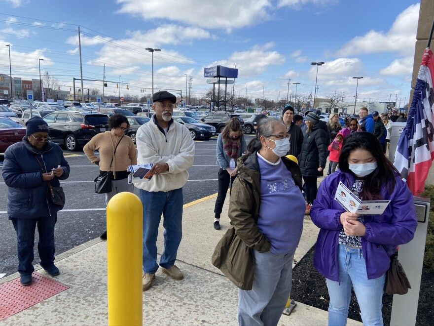Voters - some in masks - wait in line on the last day of weekend voting at Franklin County's early voting center two days before the March 17 primary. In-person voting for the primary was cancelled the next day because of COVID-19 concerns.