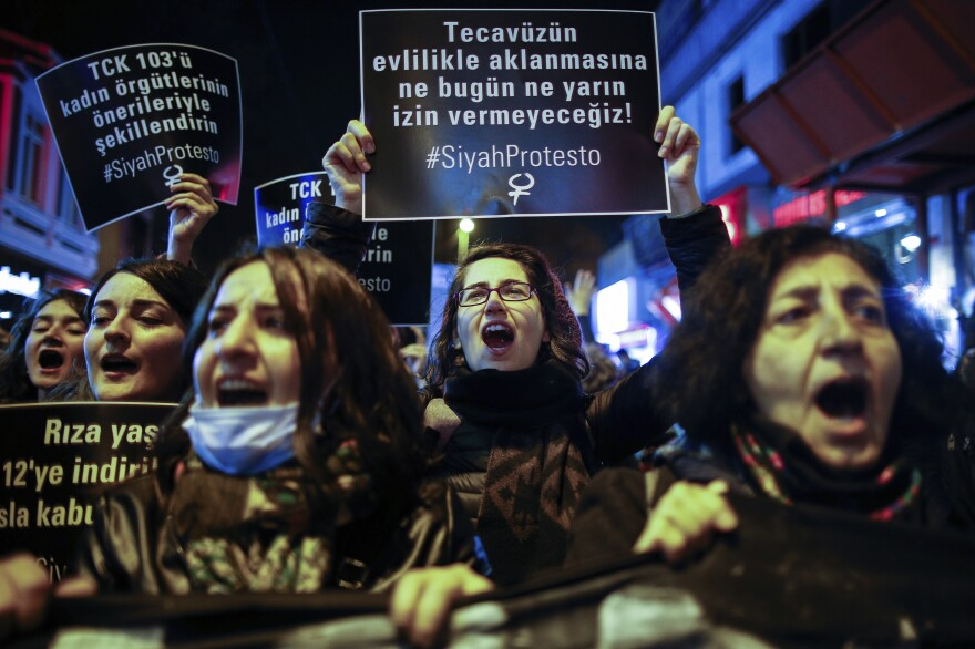 "Turkish women protest against a government proposal on Tuesday in Istanbul, Tuesday, Nov. 22, 2016. The sign in the middle reads: ""We will not allow legalized rape with marriage!"""