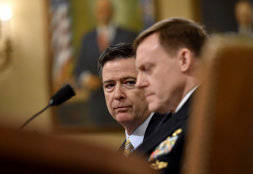 FBI Director James Comey and National Security Agency Director Mike Rogers testify during the House Permanent Select Committee on Intelligence hearing on Russian actions during the 2016 election campaign.