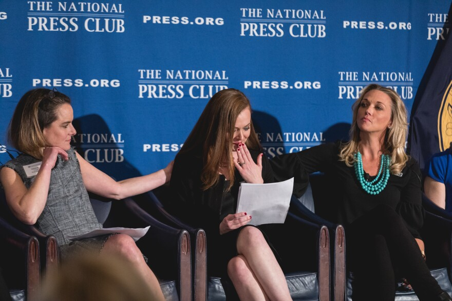 Carolyn McGourty (center) tells her story of sexual harrassment, as panelists Dianna May (left) and Addie Zinone, show their support, at the Press Forward launch event in March 2018. Press Forward is an initiative created to end sexual harassment and assault and create lasting culture change in American newsrooms.