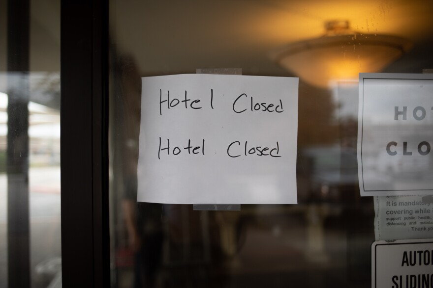 "A sign reads ""Hotel Closed Hotel Closed"" on the window of the building that will be St. Jude Center Park Central."