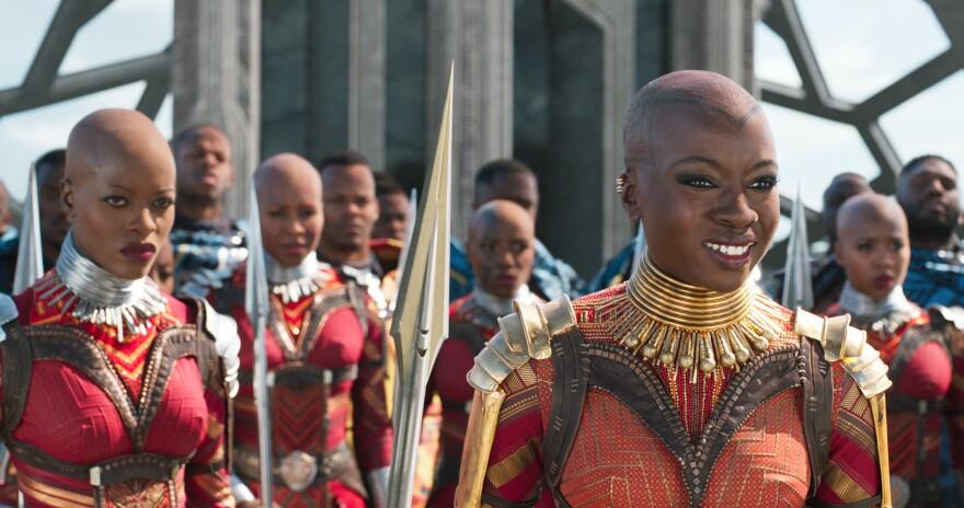 Ayo (Florence Kasumba, left) and Okoye (Danai Gurira) are members of the Dora Milaje, the elite female warriors of Wakanda, in <em>Black Panther.</em>
