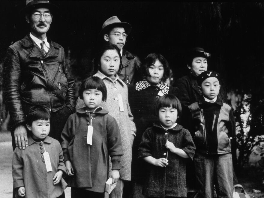 Members of the Japanese American Mochida family, in Hayward, Calif., await relocation to an incarceration camp during World War II.