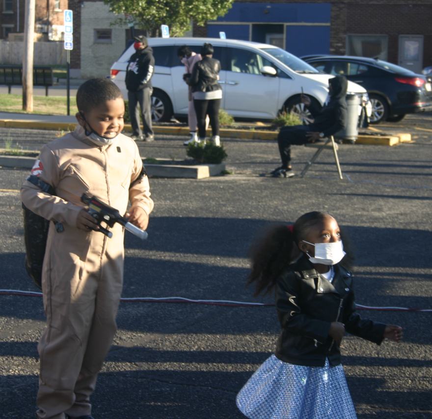 A Ghost Buster chases Dorothy from the Wizard of Oz at the Rock the Vote Rally in Dayton on Saturday