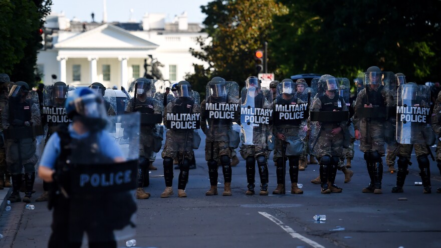 Military police hold a line near the White House as demonstrators gather to protest police brutality on June 1, 2020 in Washington, D.C.
