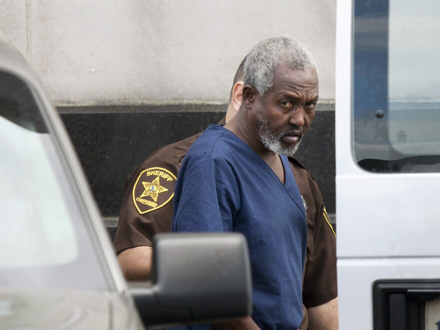 Mohammad Saaili Shibin, a Somali man accused of acting as chief negotiator for pirates who killed four American hostages, is transported from the U.S. District Court in Norfolk, Va., after a hearing on April 13, 2011.