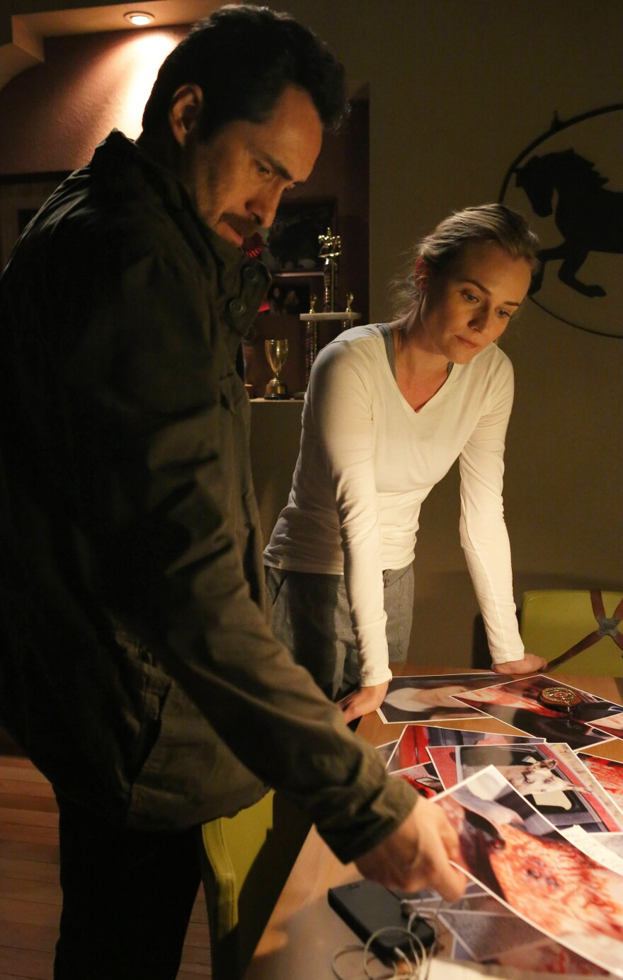 Demian Bichir, left, and Diane Kruger star in FX's cross-border crime drama <em>The Bridge.</em>