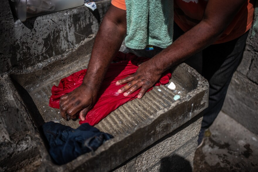 A Central American migrant washes clothes at the shelter. Experts estimate that 400,000 Central Americans enter Mexico as migrants or refugees each year.