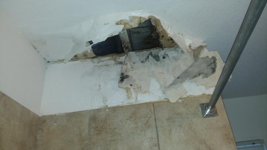 090120_hole in bathroom ceiling.Sandoval.jpg_trial exhibit