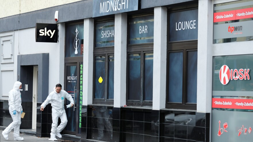 Forensic investigators enter the Midnight shisha bar after a shooting in Hanau, near Frankfurt, Germany. Federal prosecutors have taken over the case, citing a possible motive of far-right extremism.
