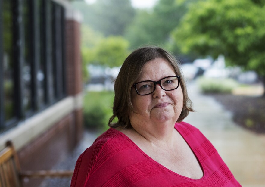Donna Shelker poses for a portrait outside the MS Center of St. Louis, where she is a patient.