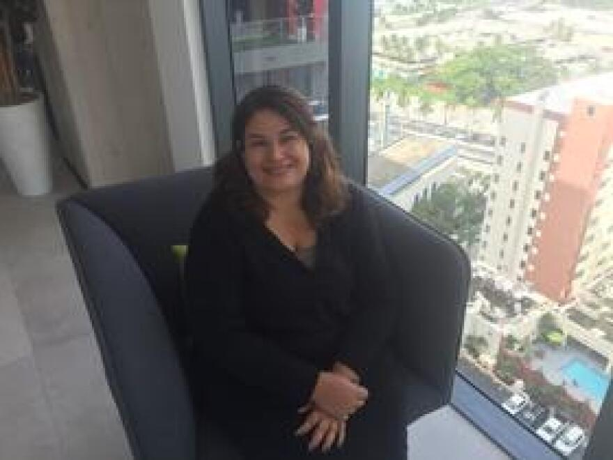 Recently arrived Puerto Rican and political activist Maruxa Cardenas at her apartment building in Miami.