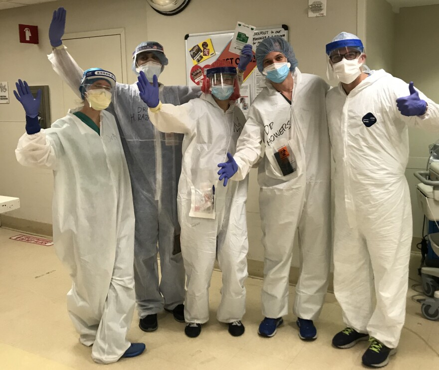 Photo of people wearing personal protective equipment